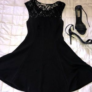 black short skater dress with lacing at the top
